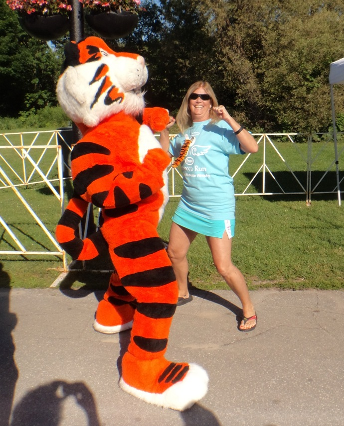 Tony the Esso Tiger and Glenis whooping it up!