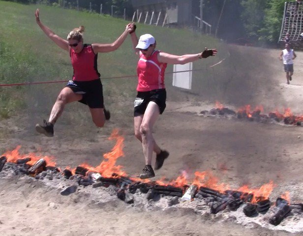 The Sister leaping over the raging fire at the first Warrior Dash at Horseshoe a couple of years ago. We just had to try it again - what a hoot!