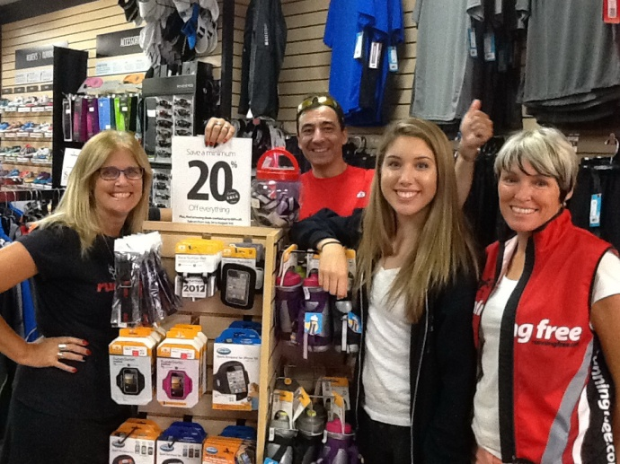 Glenis with some of that staff and Running Free team athletes who came in to help at the sale.