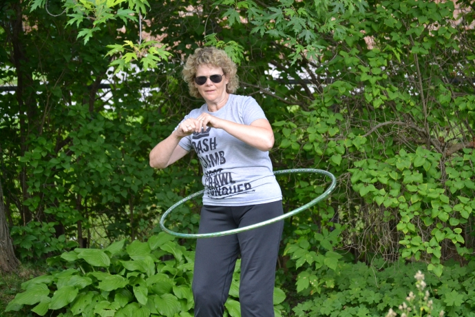 It really is a lot of fun, the look on my face is just concentration to keep the hoop moving!